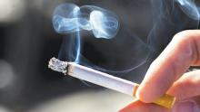 CIGARETTE COMPANIES BE COMPELLED TO FUND CANCER RESEARCH?